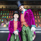 Ross Dawes as Wonka and Troy Tipple as Charlie look at the Biscuiteers Chocolate Factory outside Waterstones Picadilly. Image c. David Jensen.