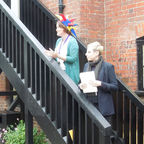 Reading the poem to visitors at the Museum