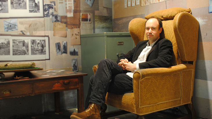 Josh Lacey in the replica of Roald Dahl's chair in the Roald Dahl Museum