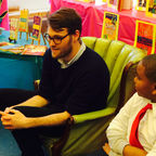 Luke Kelly reads to students at P.S. 8 Luis Belliard in New York City, credit: Thomas Dolan