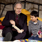 Nigel Planer (Grandpa Joe in the musical production of Charlie and the Chocolate Factory) reads to children from Dyslexia Action, image c.  Filipa Esteves
