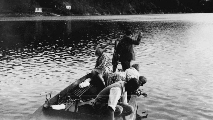 Photograph of Roald Dahl and family in a dinghy 1924 C. RDNL.