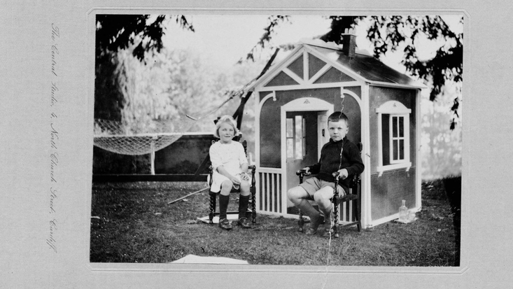 Roald Dahl and Alfhild outside their wendy house in Radyr, 1920