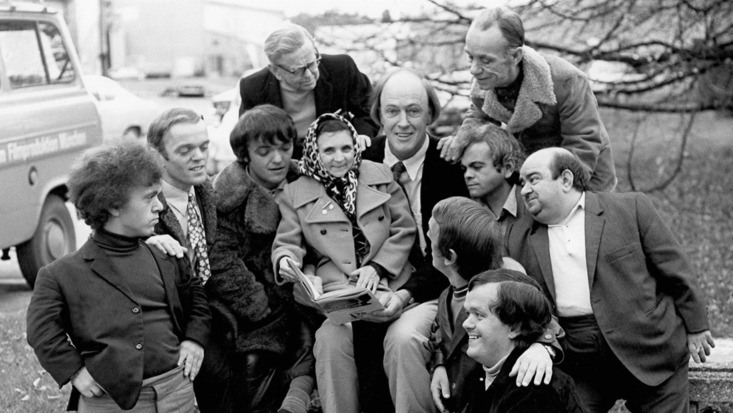 Roald Dahl with group of Oompa-Loompa actors during filming