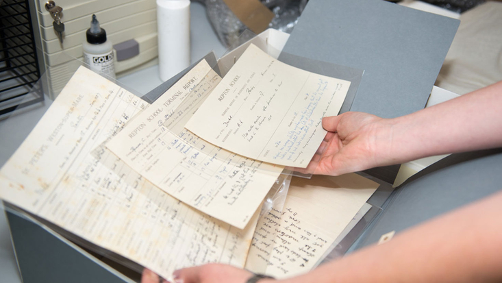 Woman holding papers from Roald Dahl's archive