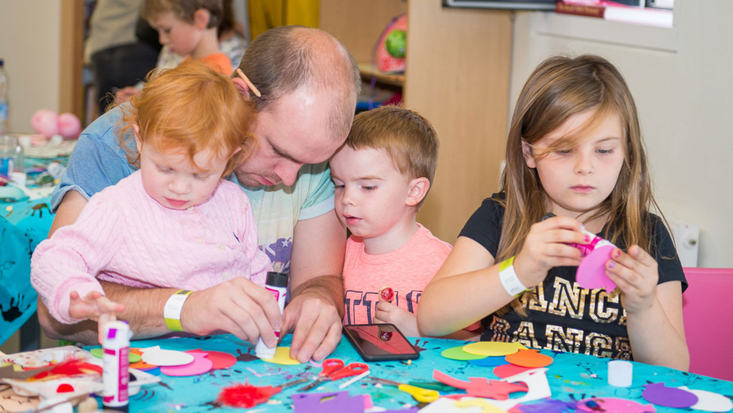 Family enjoying a craft workshop at the Roald Dahl Museum