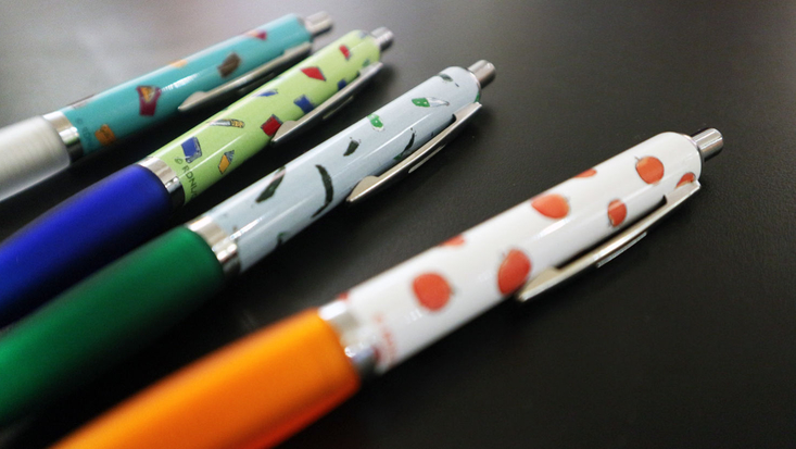 Four Roald Dahl pens on a desk