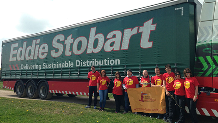 Group of fundraisers with Stobart truck