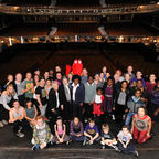 Julie Walters on stage with Felicity Dahl, musical cast and charity beneficiary children