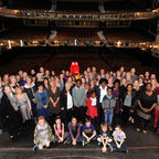 Julie Walters on stage with Roald Dahl nurses, cast and children